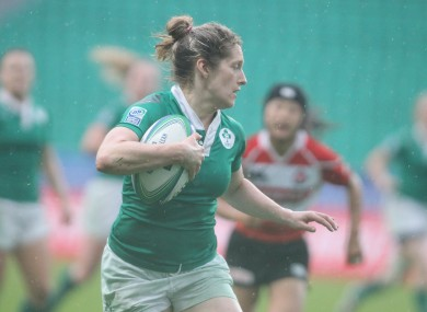 Alison Miller races in for one of her three tries.