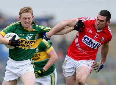 Kerry's Colm Cooper and Cork's Noel O'Leary.