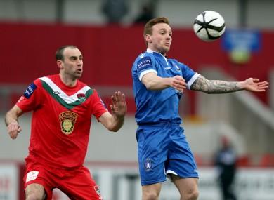 Dan Murray of Cork with Craig Curran of Limerick.