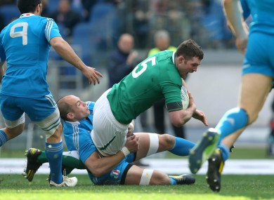 Ireland's Donnacha Ryan tackled by Italy's Sergio Parisse.