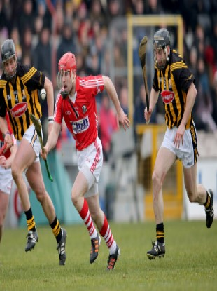 Kilkenny's Jackie Tyrrell and Conor Fogarty chase after Stephen Moylan of Cork.
