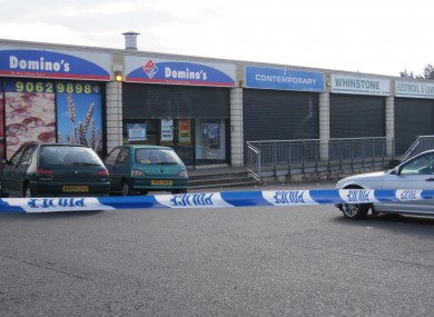 A general view of the area outside Domino's Pizza in the Turf Lodge area in the west of Belfast where pizza delivery Kieran McManus driver was killed when he was gunned down at close range in front of three close friends.