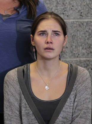 Oct. 4, 2011 file photo Amanda Knox gestures at a news conference in Seattle Tuesday, Oct. 4, 2011, after returning home from Italy.