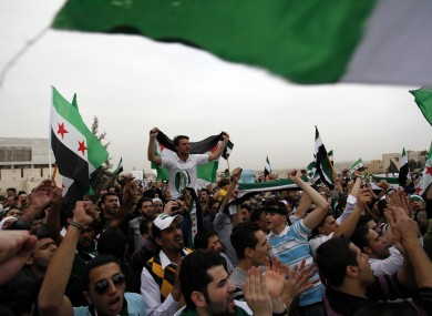 Syrian protesters chants anti-Assad slogans during a celebration to commemorate the second anniversary of the Syrian revolution, in Amman, Jordan