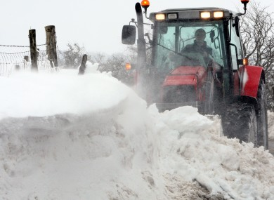 A tractor attempts to clear drifting snow in the hills above the Glens of Antrim over the weekend.