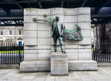 The starry plough and the flag of the Irish Citizens Army as seen behind the statue of bronze statue of James Connolly.