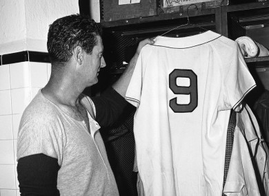 Ted Williams, Boston Red Sox slugger, hangs up his shirt with No 9 on it for the last time