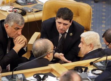 Wael al-Halqi talking with officials at a summit in Iran last year.