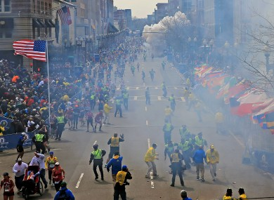 People react as an explosion goes off near the finish line of the 2013 Boston Marathon in Boston, yesterday.