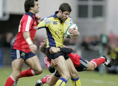 Clermont's Julien Malzieu is tackled by Munster's Shaun Payne (right) and Brian Carney.