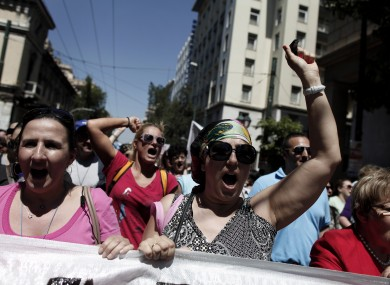 Municipal workers chant anti-austerity slogans during a protest against government plans to lay off thousands of public sector workers.