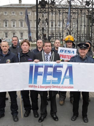 A protest by IFESA outside the Dáil earlier this year. John Kidd (pictured centre wearing suit) is the chairman of the group.