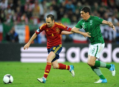 Andres Iniesta goes past Keith Andrews at Euro 2012.