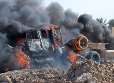 A burning Iraqi army military vehicle, , April 23, 2013.