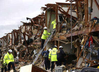 Firefighters conduct search and rescue of an apartment destroyed by an explosion at a fertilizer plant in West, Texas.