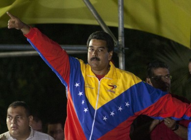 Nicolas Maduro celebrates his victory after the official results were announced last night