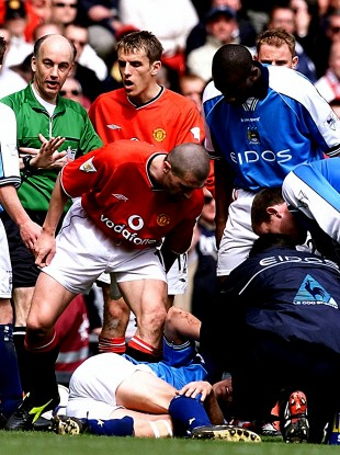 Roy Keane stands over Alfie Haaland.