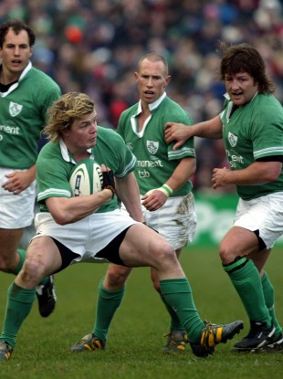 Brian O'Driscoll makes a move in 2004 as Shane Byrne (r) looks on.