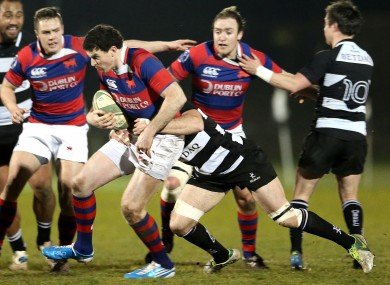 Richie Lane of 'Tarf in action against another black and white clad team.