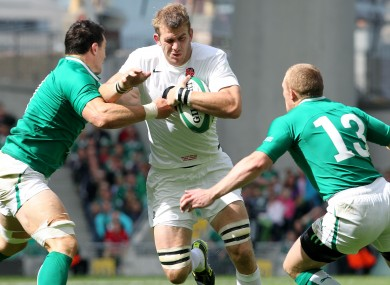 David Wallace and Keith Earls tackle Tom Croft in 2011.
