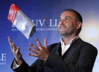 Colum McCann poses with his book 'Let the Great World Spin' after winning the Literary Award at the 35th American Film Festival in Normandy, France, in 2009.