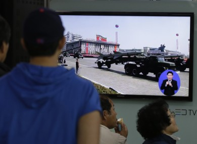 South Koreans watch TV news showing a footage of North Korean missiles on a military parade, at a Seoul Train Station in Seoul,