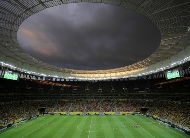 Clouds loom over the National Stadium during the Group A Confederations Cup opening match between Brazil and Japan, in Brasilia.