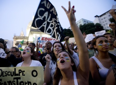 People shout slogans during an anti-government demonstration in Rio de Janeiro, Brazil.