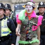 An anti-globalization protester walks amongst police officers during a protest march through Sheffield's city centre to demonstrate against the G8 in 2005. (AP Photo/Jane Mingay)