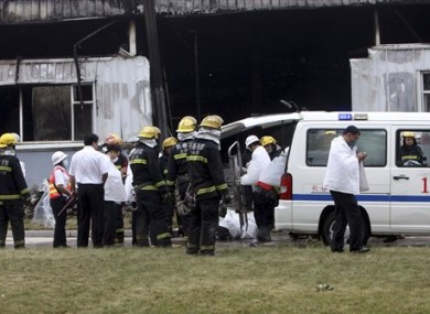 Emergency services comb the scene in the aftermath of the blaze