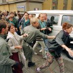 A policeman chases anti-summit protesters outside the G7 economic summit at Munich's Residenz on 6 July, 1992. Nearly 200 demonstrators were arrested. (AP Photo/Fritz Reiss)