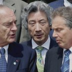 British Prime Minister Tony Blair and French President Jacques Chirac chat as Japanese Prime Minister Junichiro Koizumi listens at the G8 Summit at the Gleneagles Hotel near Auchterarder, Scotland in 2005.  (AP Photo/Junji Kurokawa)