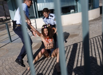 An activist from the women's movement Femen is dragged away by police officers during a protest in front of the German chancellery ahead of the visit of Tunisian Prime Minister Ali Laarayedh in Berlin last week. The group was pleading for Angela Merkel to push for the release of four fellow activists jailed in Tunisia.