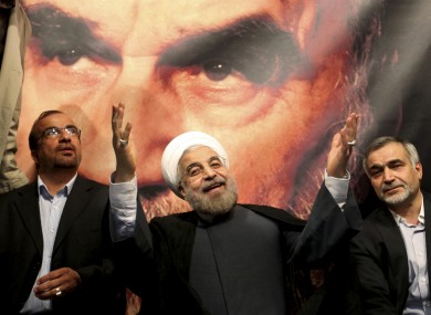 n front of a portrait of the late Iranian revolutionary founder Ayatollah Khomeini, Iran's new president Hasan Rowhani