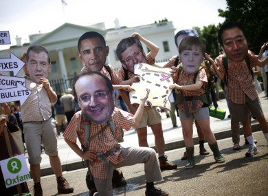 Oxfam activist wearing masks depicting G8 world leaders participate in a demonstration outside the White House in Washington last year
