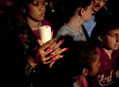 A woman in Pretoria prays for former South African President, Nelson Mandela.