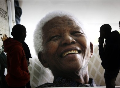 Giant photographs of former president Nelson Mandela are displayed at the Nelson Mandela Legacy Exhibition at the Civic Centre in Cape Town today.