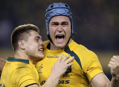 James Horwill celebrates Australia's win with James O'Connor (l)