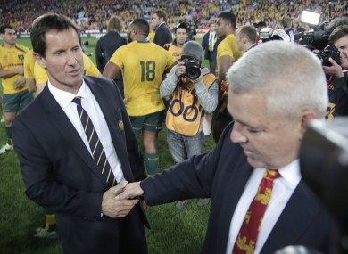 Robbie Deans shakes hands with winning Lions coach Warren Gatland.