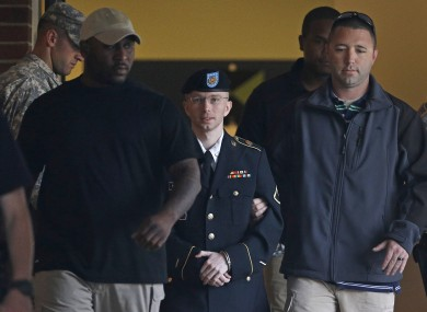 Bradley Manning (centre) is escorted to a security vehicle outside the courthouse in Maryland yesterday