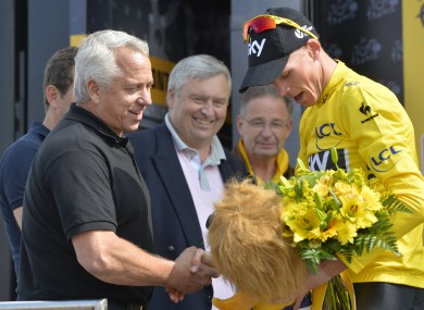 Greg LeMond and Britain's Chris Froome of Team Sky in the yellow jersey yesterday.