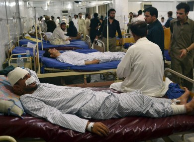 Injured victims of Friday's bombing at a busy market, is treated at Lady Reading Hospital in Peshawar, Pakistan, Saturday, July 27, 2013.
