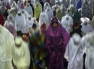 Muslim women perform an evening prayer called