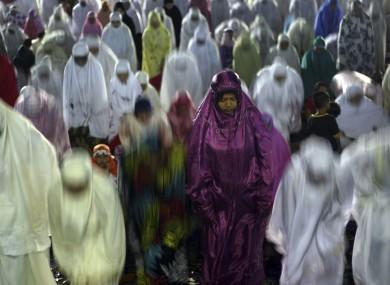 Muslim women perform an evening prayer called
