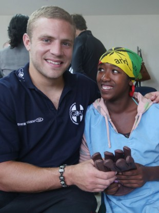 Ian Madigan with a female worker from the Pittard factory.
