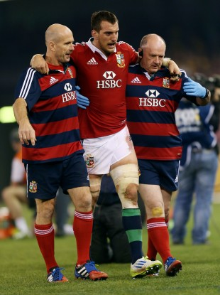 Warburton is helped off the field during the Lions game with Australia.