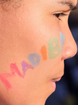 An unidentified girl with her face painted with the word 'Madiba' in reference to Nelson Mandela, stands outside the Mediclinic Heart Hospital where former South African President Nelson Mandela is being treated.