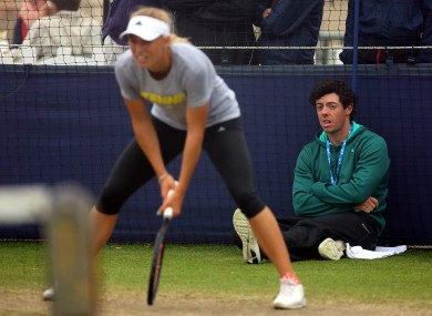 Rory McIlroy watches girlfriend Caroline Wozniacki in practice at the Aegon championships.