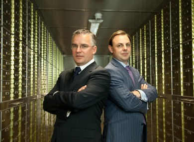 Seamus Fahy and David Walsh, standing in the vault amongst the safety deposit boxes.