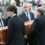 Mourners carry Colm Murray's coffin. <span class=